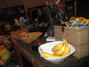 Chips and fresh fruit at the Pirates and Pals pre-cruise event