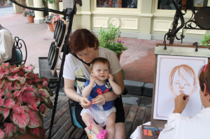 Fancy Free Daughter getting her caricature drawn