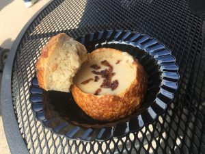 White Cheddar Ale Soup with Bacon in a Bread Bowl