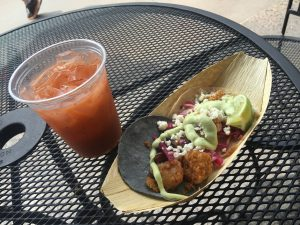Fried Shrimp Soft Taco with Avocado Crema and Pickled Onions and Strawberry Fresca Drink