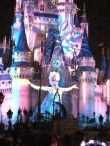 "Elsa sings ""Let it Go"" during Celebrate the Magic projection show at Magic Kingdom Park."