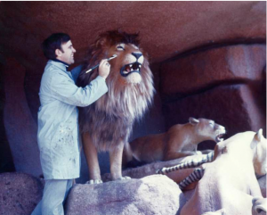 R.J. painting a lion on Jungle Cruise