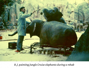 R.J. painting elephants during Jungle Cruise refurb