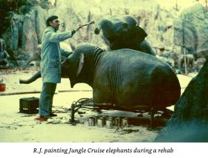 R.J. painting elephants during Jungle Cruise refurb