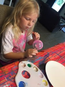 Painting her ornament