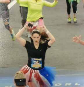Crossing the finish line! Sure wish this was included in my 2014 Memory Maker! Photo courtesy of MarathonPhoto.