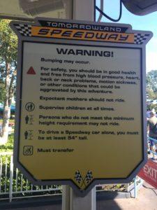 Tomorrowland speedway warning sign, car raceway, driving, line