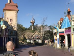 Waiting to leave Fantasyland at park opening