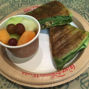 Cup of Fresh Cut Fruit, grapes, cateloupe and honeydew and a vegetarian/vegan wrap cut in two