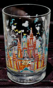 McDonald's glassware from Walt Disney World features Cinderella Castle with pink birthday cake overlay