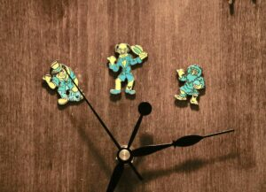 Hitchhiking Ghost Disney Trading Pins on handcrafted clock