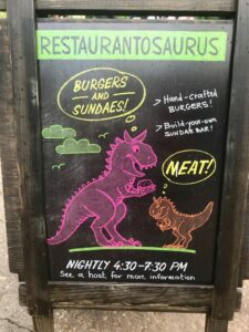 A sign makes it easy to find Restaurantosaurus Gourmet Burgers and Sundaes